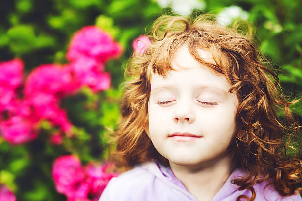 Beautiful girl closed her eyes and breathes the fresh air Beautiful girl closed her eyes and breathes the fresh air in the park. human nose stock pictures, royalty-free photos & images