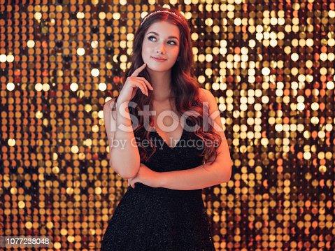 Beautiful girl dancing at the nightclub