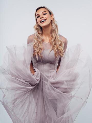 Beautiful girl dancing with flying fabric