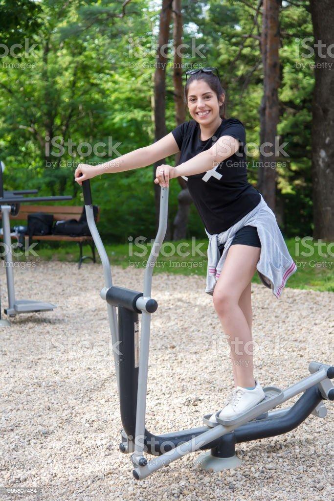 Beautiful girl doing exercises outside. - Royalty-free Adult Stock Photo