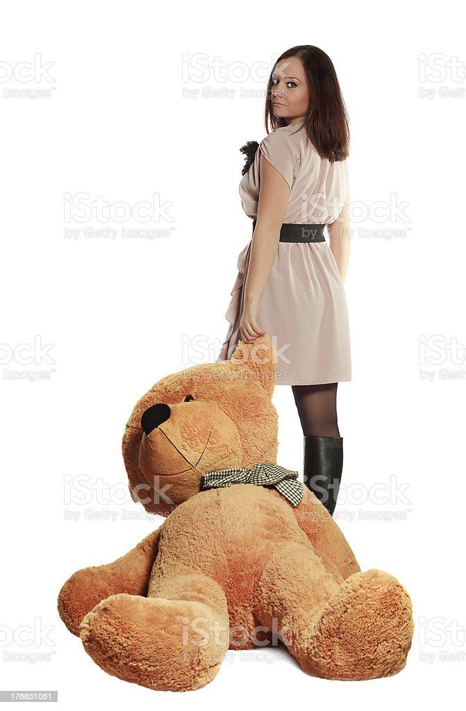 beautiful girl draging toy bear stock photo