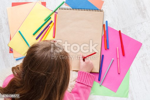 istock Beautiful girl draw, writing letter to santa, wait for christmas 626438572