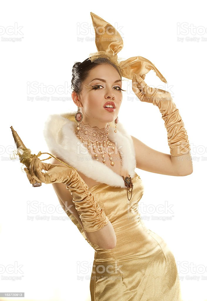 beautiful girl dressed up as a gold rabbit stock photo