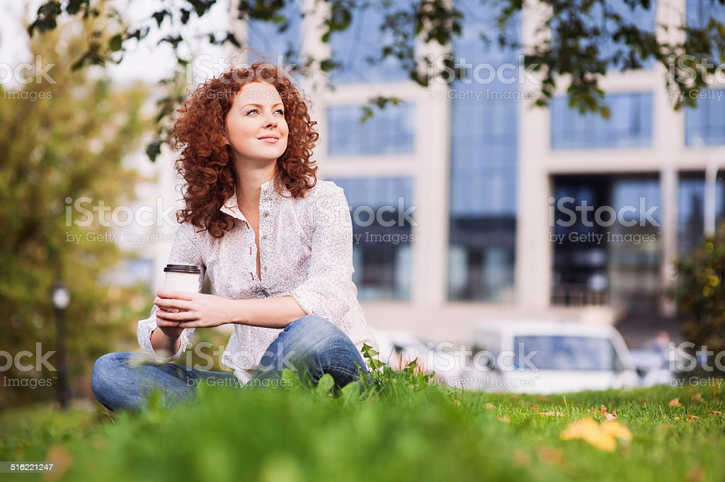 Beautiful girl drinking coffee outdoors stock photo