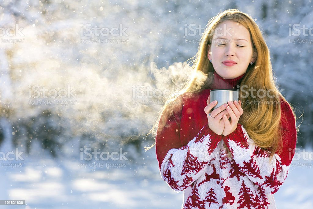 Beautiful girl drinking hot drink on winter royalty-free stock photo