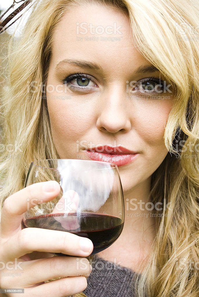 Beautiful girl drinking wine royalty-free stock photo