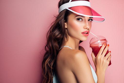 Beautiful girl drinks smoothies