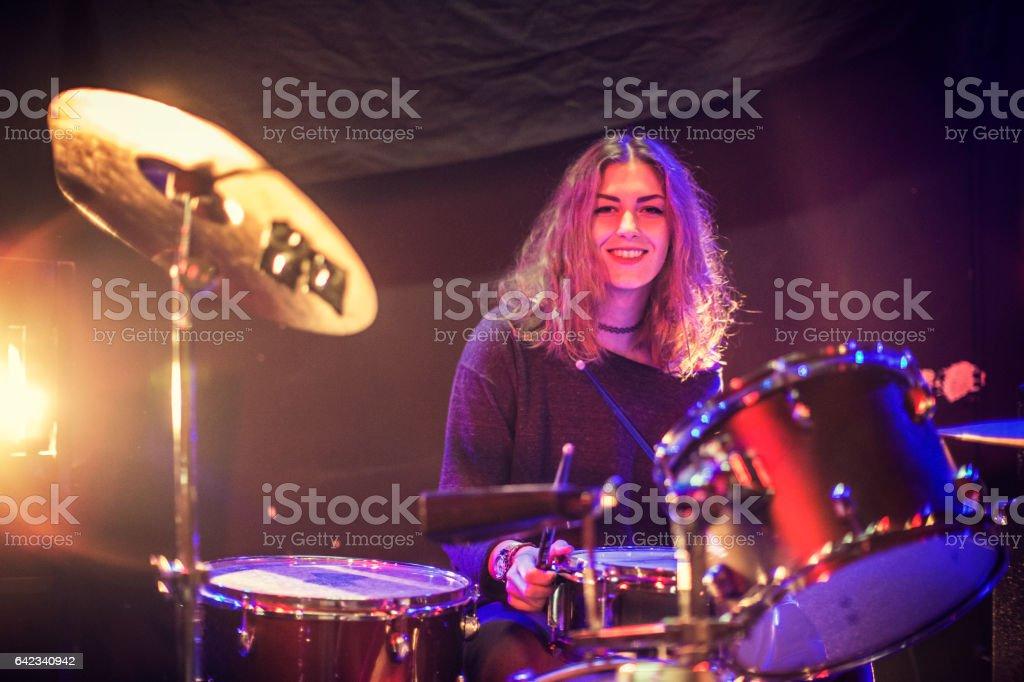 Beautiful girl drummer stock photo