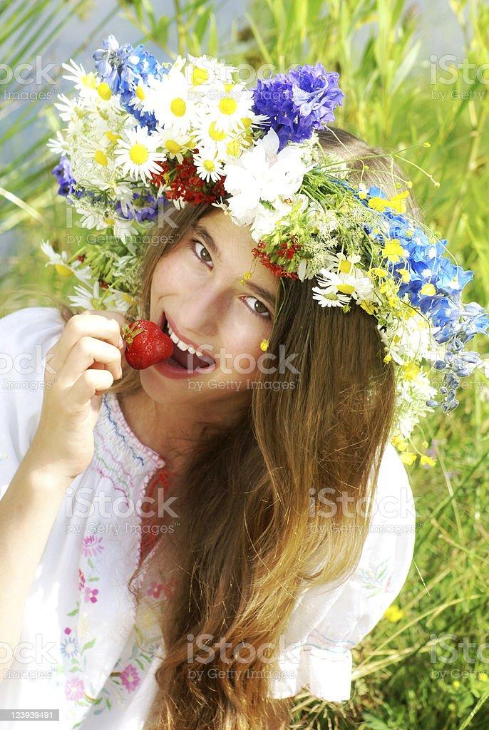 Beautiful girl eating strawberry royalty-free stock photo