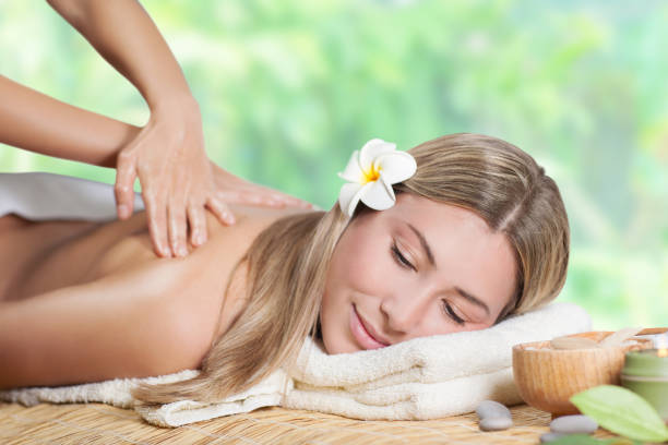 Beautiful girl enjoying day spa stock photo