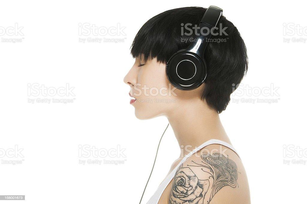 Beautiful girl enjoying music with eyes closed stock photo