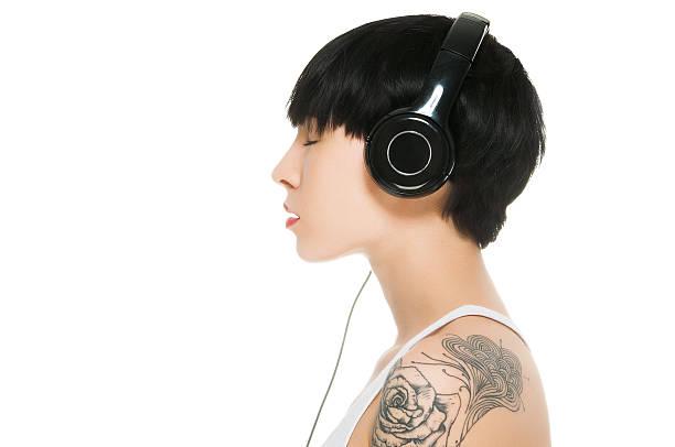 Beautiful girl enjoying music with eyes closed