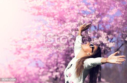 istock Beautiful girl enjoying nature 928910096