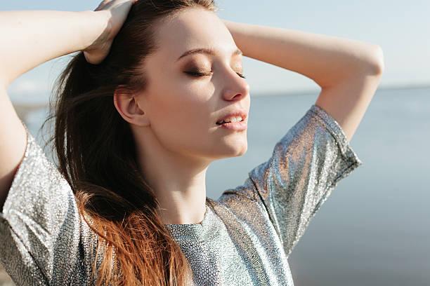 Beautiful girl enjoying the sun and the warmth stock photo