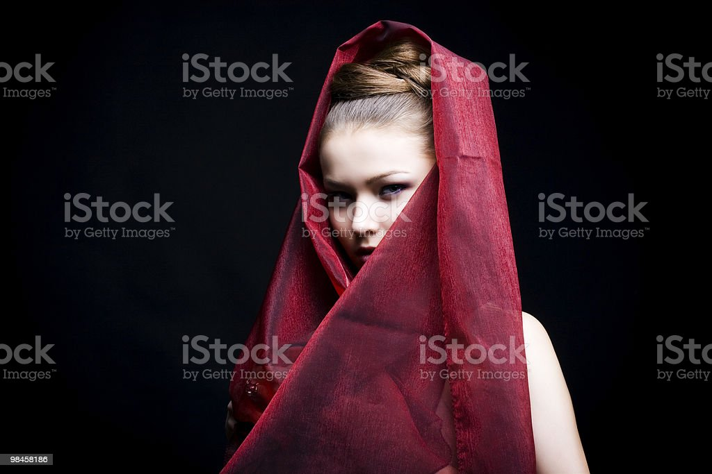 beautiful girl enveloped  in red headscarf royalty-free stock photo