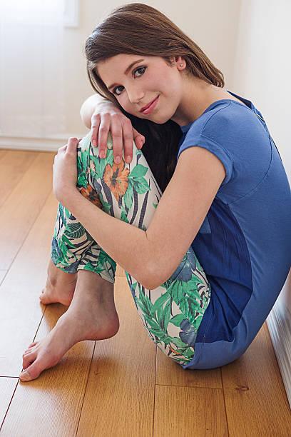 Beautiful girl fashion model sitting on floor stock photo