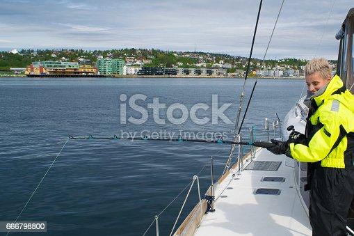 155674939 istock photo Beautiful girl fishing in northern Norway 666798800