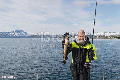 155674939 istock photo Beautiful girl fishing in northern Norway 666798852