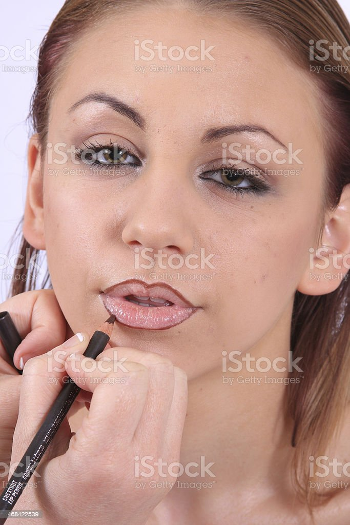 Beautiful Girl Getting Her Makeup Done stock photo