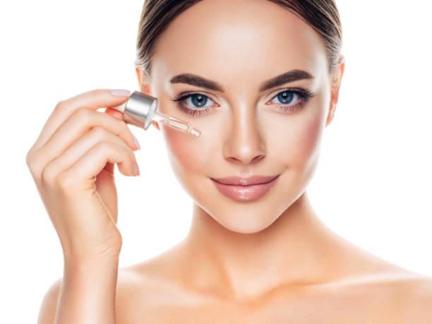 Beautiful girl getting skin anti aging treatment stock photo
