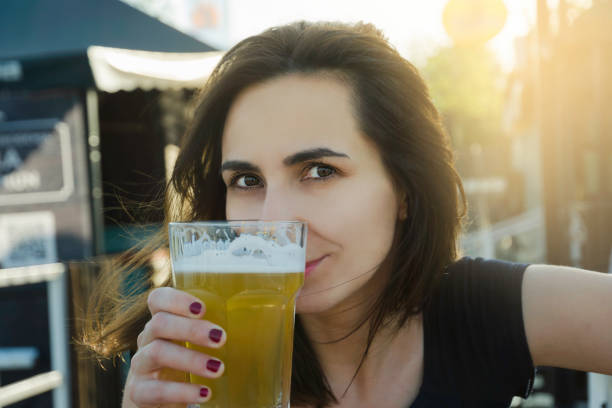 Beautiful girl having a beer. stock photo