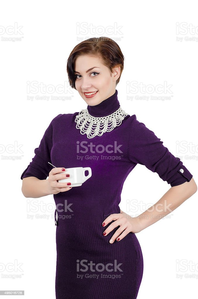 Beautiful girl holding a cup of coffee (tea). Isolated stock photo