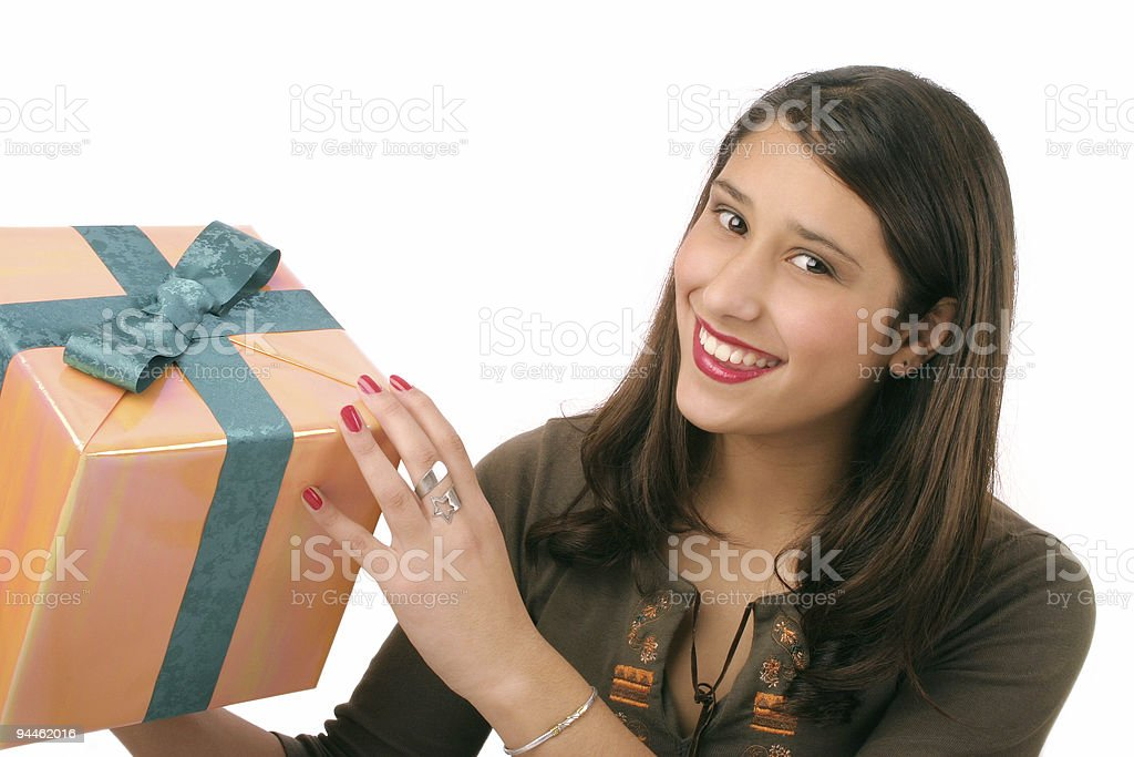 Beautiful girl holding a present royalty-free stock photo