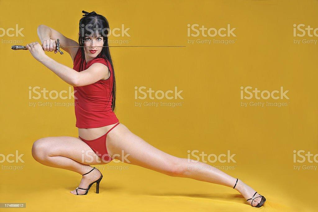 Beautiful girl holding a sword stock photo