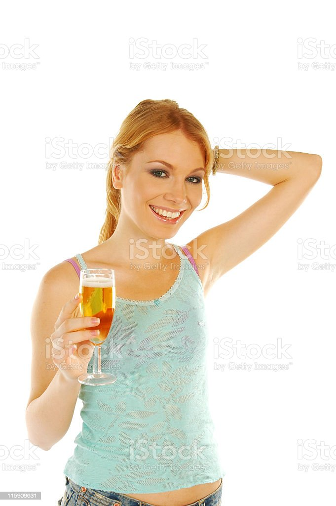 Beautiful girl holding glass of beer, smiling royalty-free stock photo