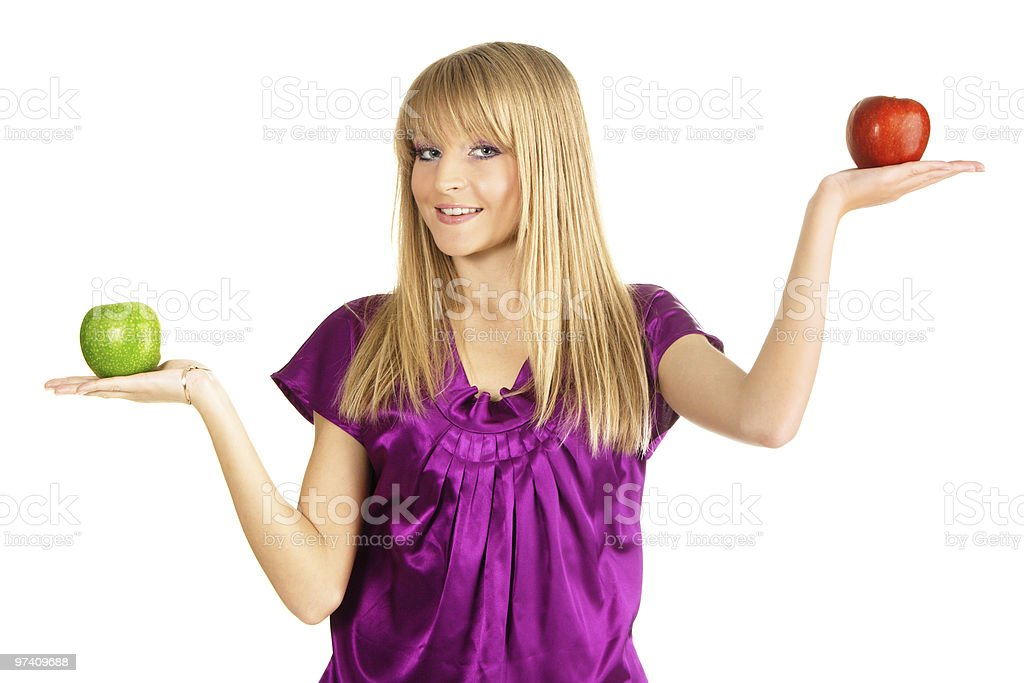 Beautiful girl holding two fresh apples royalty-free stock photo
