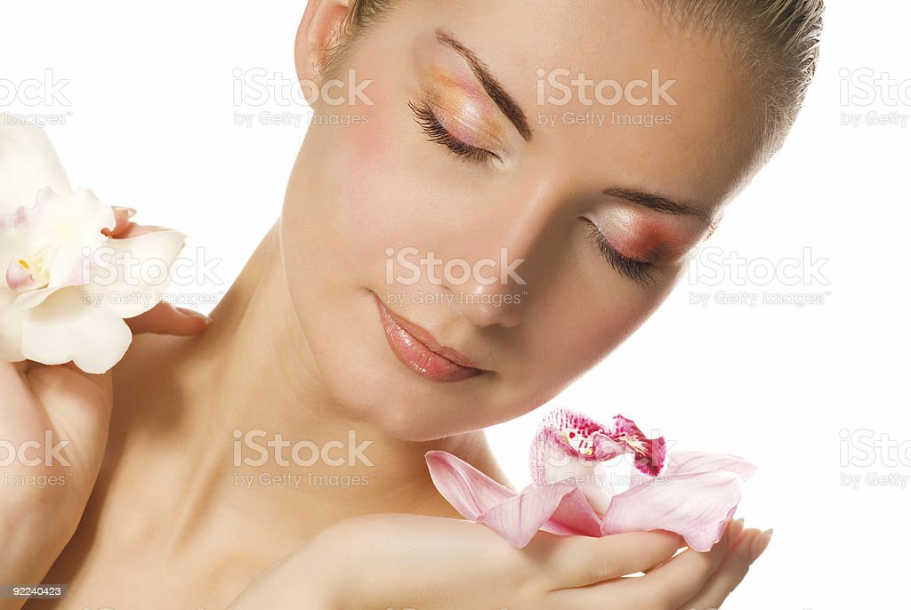 Beautiful girl holding two orchids in her hands royalty-free stock photo