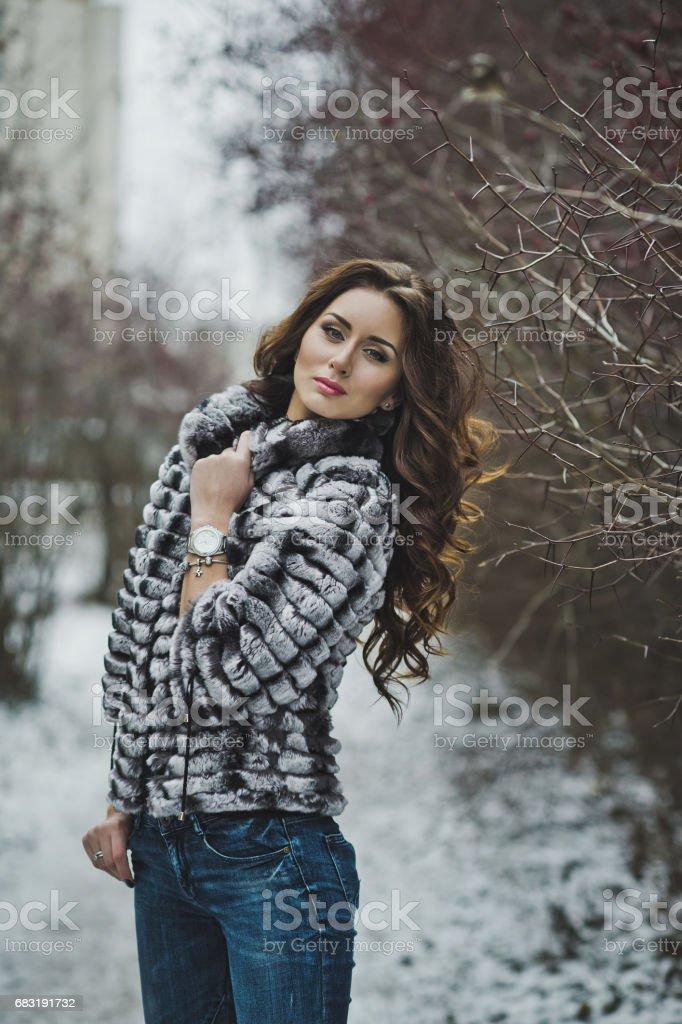 Beautiful girl in a fur coat on a winter walk 4979. 免版稅 stock photo