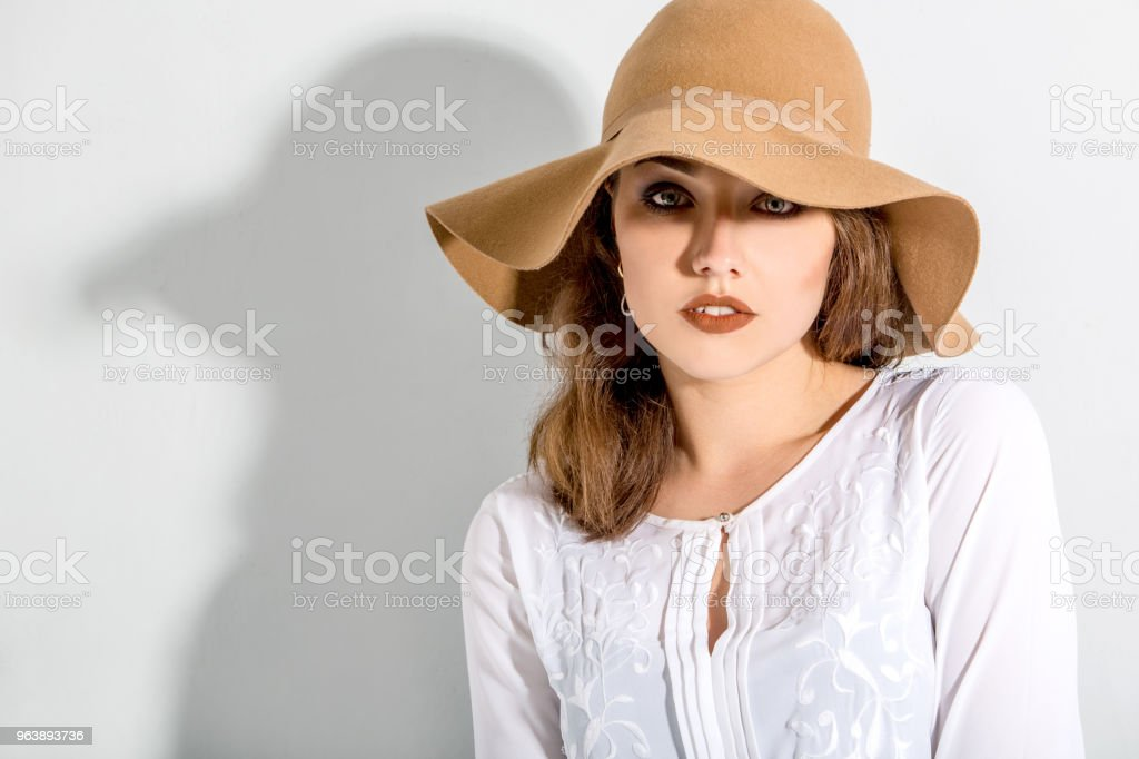 Beautiful girl in a hat - Royalty-free Adult Stock Photo