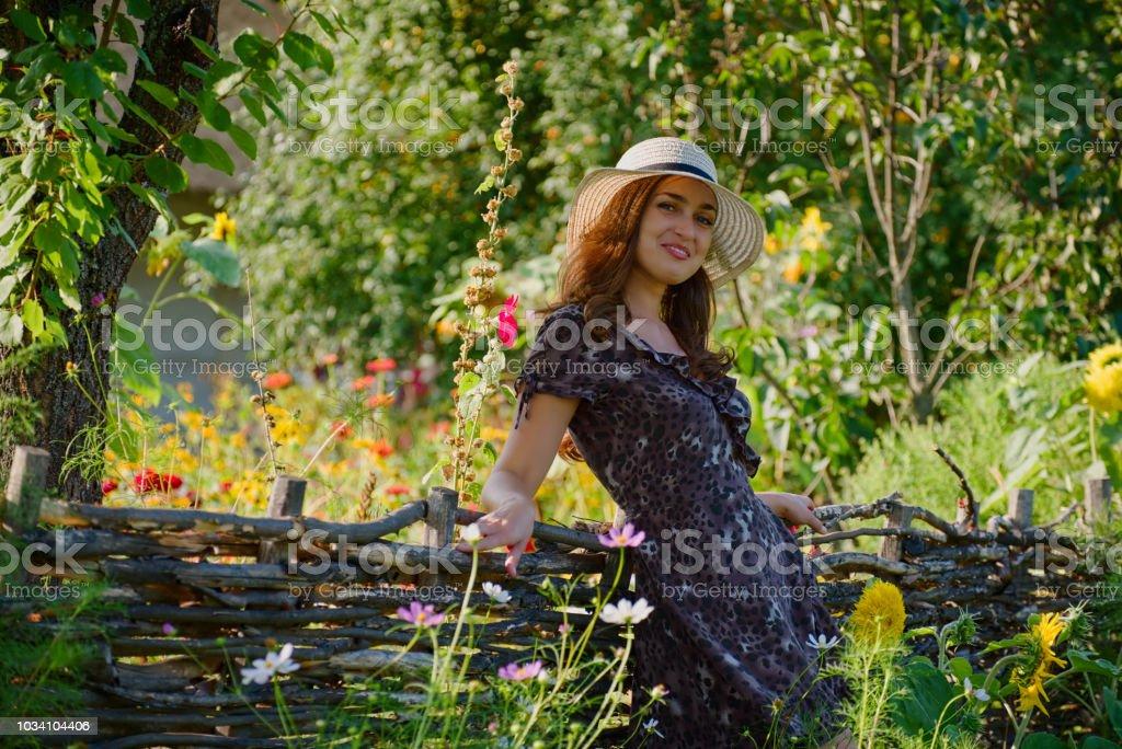 Beautiful girl in a picturesque summer garden stock photo