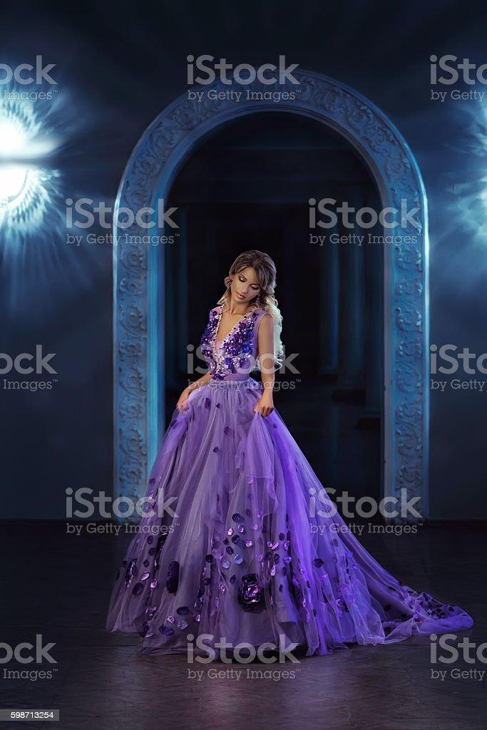 Beautiful girl in a purple dress stock photo