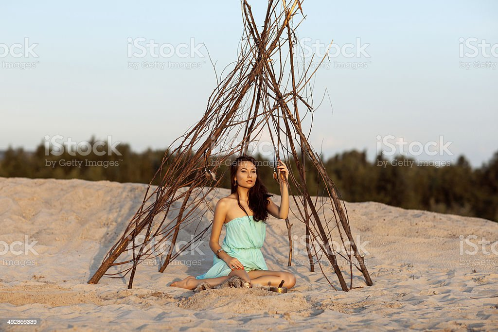 Beautiful girl in a tent shaman. royalty-free stock photo