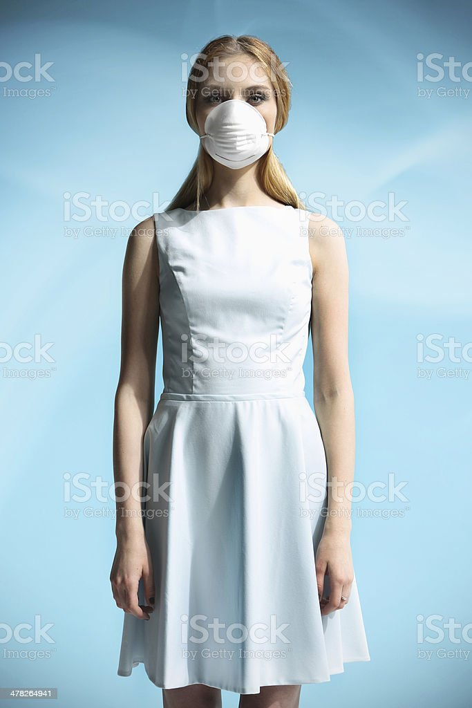 Beautiful girl in a white dress stock photo