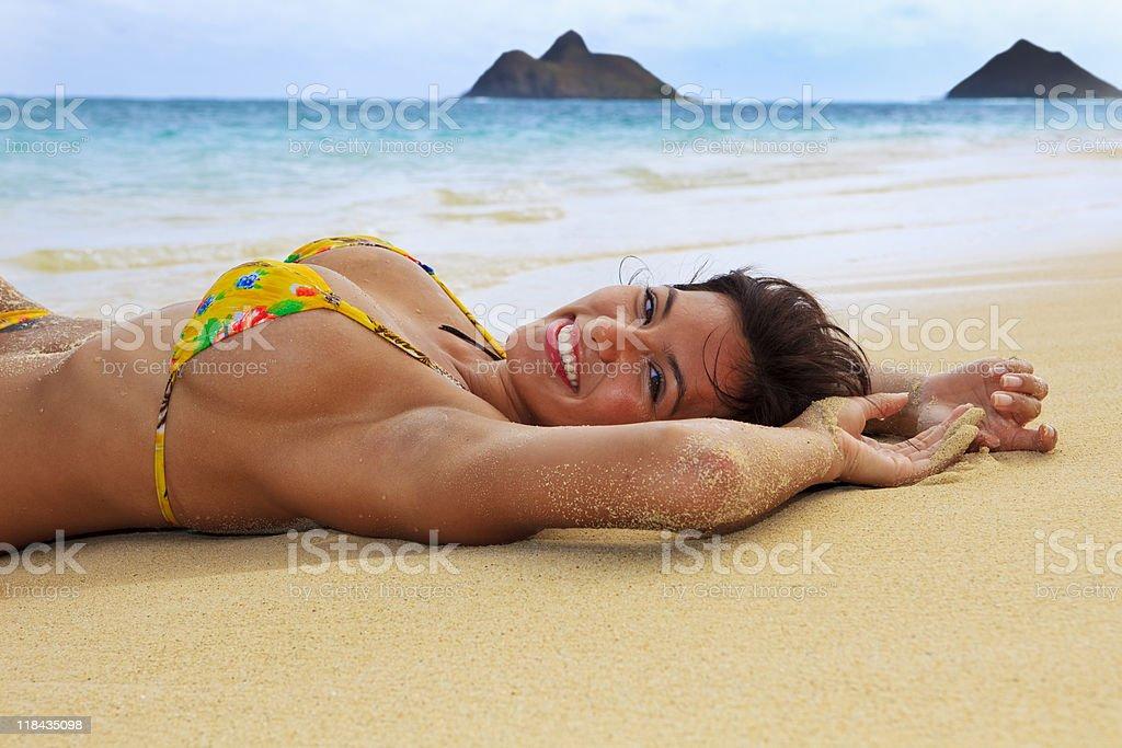 beautiful girl in a yellow bikini stock photo