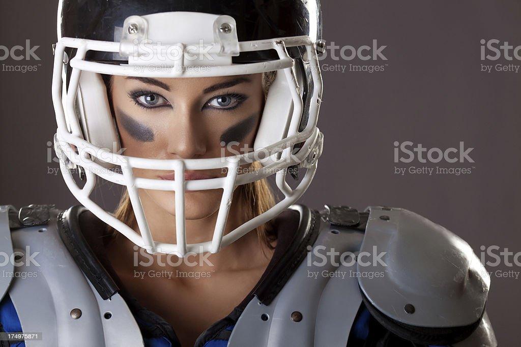 Beautiful Girl in American football gear stock photo