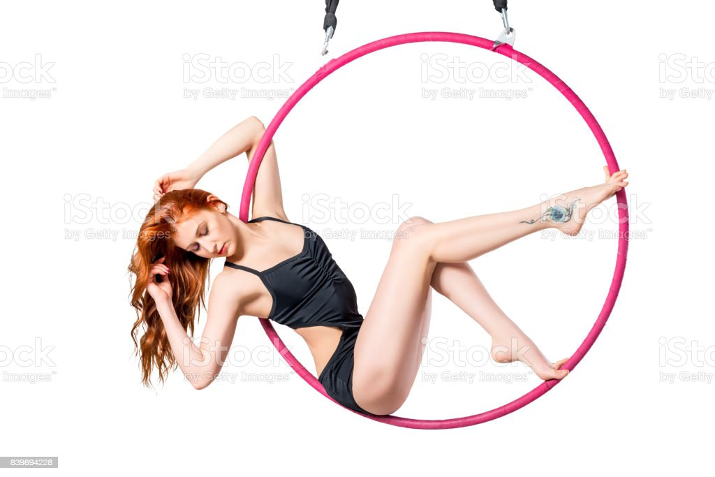 Beautiful girl in an airy ring posing on a white background stock photo