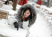 istock Beautiful girl in an outdoor cafe on a winter day 181904033