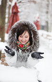 istock Beautiful girl in an outdoor cafe on a winter day 185624988