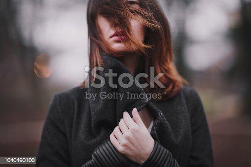 istock Beautiful girl in autumn park. 1040490100