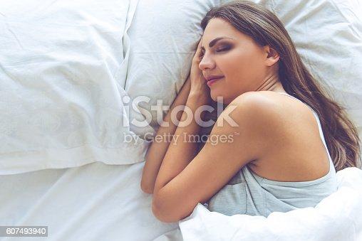 607490114istockphoto Beautiful girl in bed 607493940
