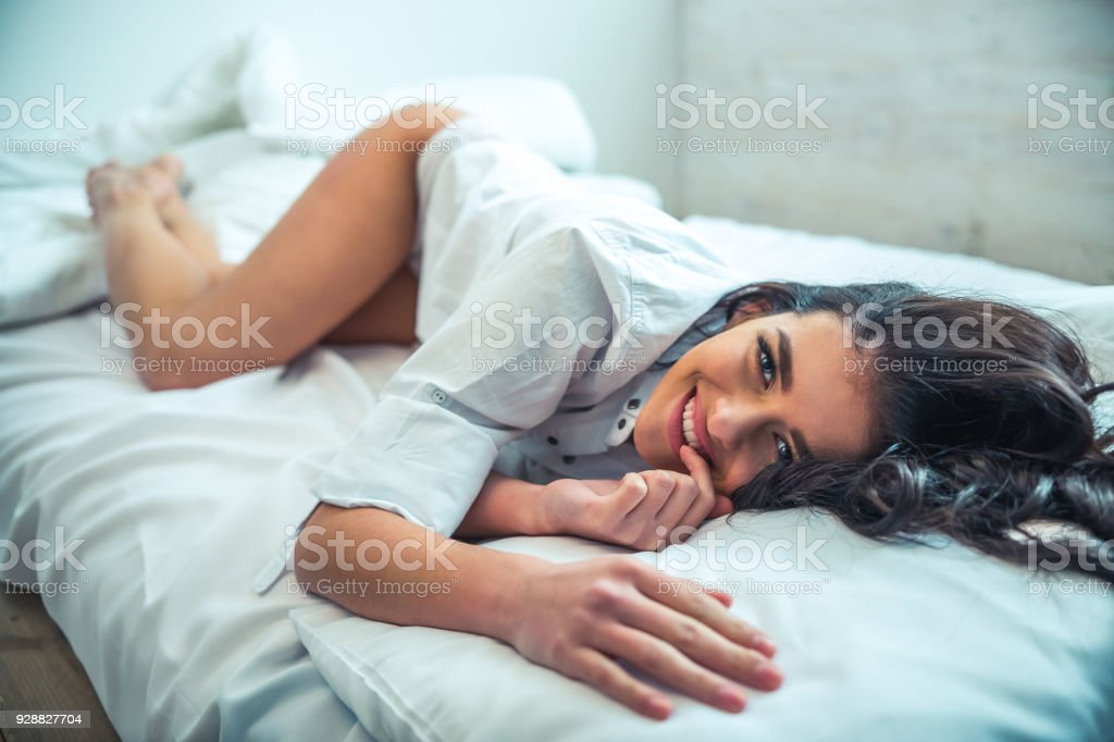 Beautiful girl in bed stock photo