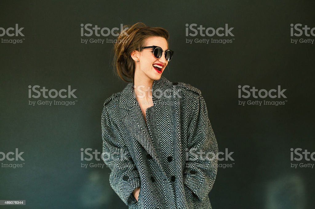 beautiful girl in coat stock photo