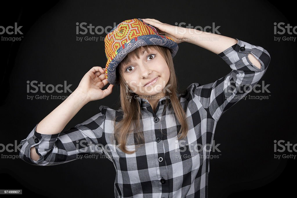 Beautiful girl in colour hat royalty-free stock photo