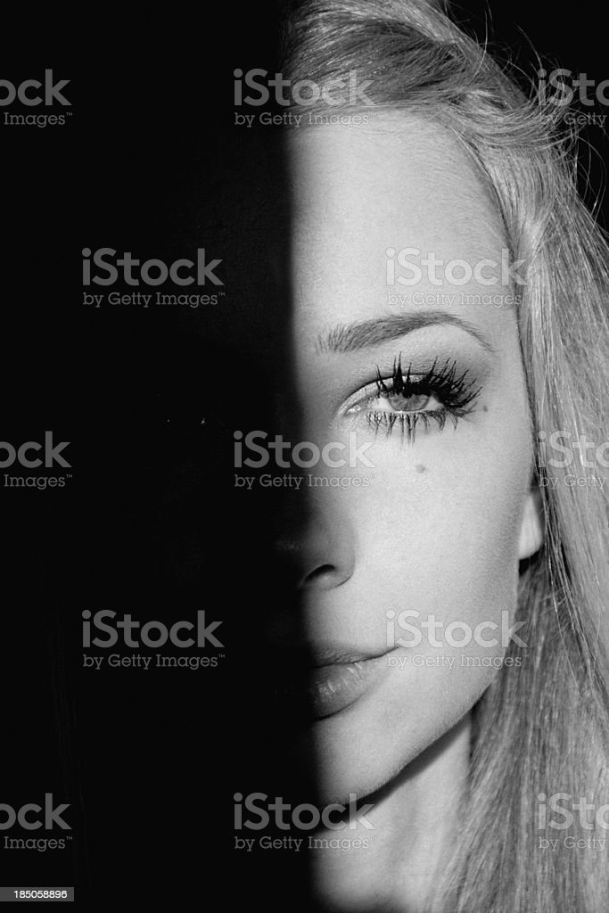 beautiful girl in contrasting light royalty-free stock photo