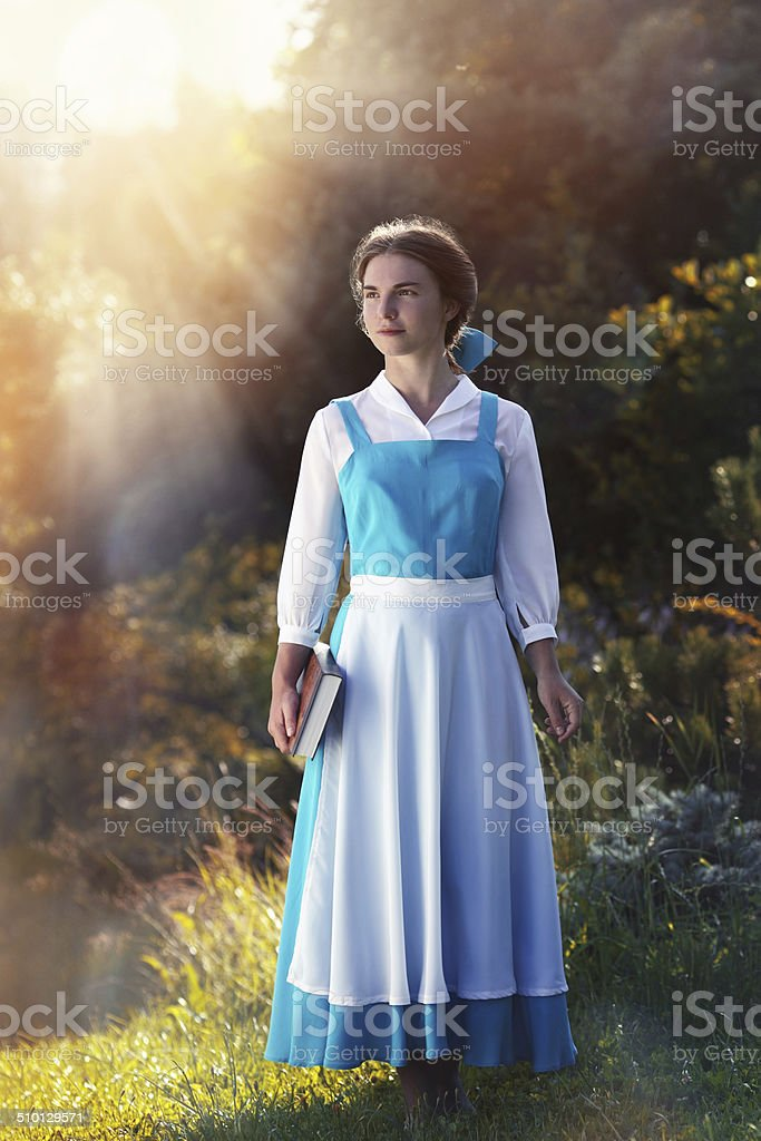 beautiful girl in cosplay Belle stock photo