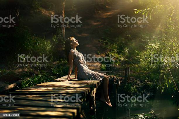 Beautiful Girl In Fairy Forest Stock Photo - Download Image Now